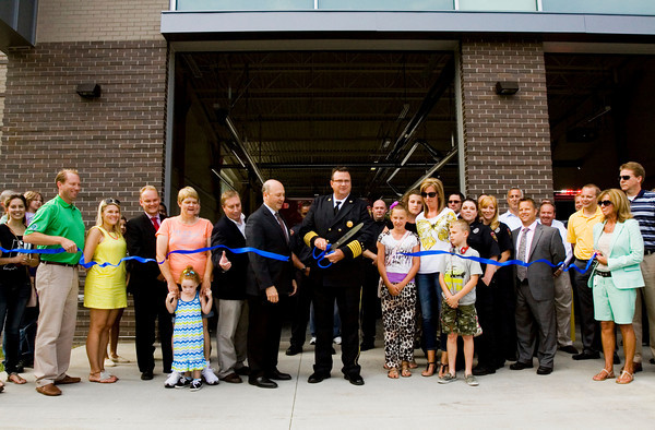 New Albany Fire Chief Matt Juliot cuts the ribbon during the grand opening of the department's new station along Daisy Lane in New Albany on Monday evening. Staff photo by Christopher Fryer