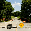 Concrete barricades block access to the bridge on Five Mile Lane in Floyd County on Friday afternoon. The bridge was recently closed for repairs after a state inspection, and the Floyd County Commissioners plan to reopen it by the end of the year. Staff photo by Christopher Fryer