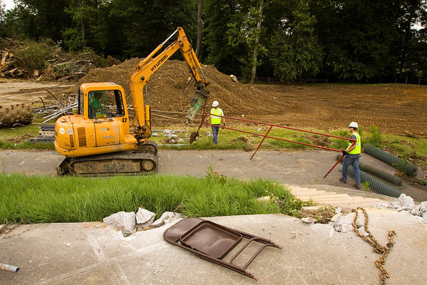 A crew with Bryan Stumler Excavating works to demolish the old facilities of the former Camille Wright Pool at the site of the new aquatic center along Daisy Lane in New Albany on Monday morning. Staff photo by Christopher Fryer