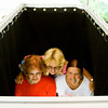 Cancer survivors Brenda Hawkins, Floyds Knobs, Helen Smith, Corydon, and Karen Steele, Lanesville, pose in a photo booth during the annual Floyd Memorial Cancer Center's Survivors Day Celebration in New Albany on Friday afternoon. Staff photo by Christopher Fryer
