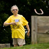 Edna Geswein, 82, Georgetown, throws during the horseshoe competition at LifeSpan Resources' 2014 Senior Games at Sam Peden Community Park in New Albany on Monday afternoon. Geswein is one of  296 participants taking part in the six-day event. Staff photo by Christopher Fryer