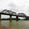 The Ohio River flows beneath the K&I Bridge on Wednesday afternoon. Officials on both sides of the river support reopening the bridge to the public, but Norfolk Southern, the transportation company that owns the bridge, is keeping it limited to railway traffic due to liability issues. Staff photo by Christopher Fryer