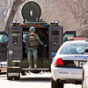 A Jeffersonville Police Department SWAT officer exits an armored vehicle at the mobile command unit near the intersection of Flintlock Drive and Middle Road during a standoff along the 1700 block of Birch Bark Lane in Jeffersonville on Monday afternoon. The suspect took his own life with a rifle. No others were injured during the incident. Staff photo by Christopher Fryer