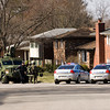 Jeffersonville Police Department officers and SWAT team members prepare equipment near the scene of a standoff in a residence located along the 1700 block of Birch Bark Lane in Jeffersonville on Monday afternoon. The suspect took his own life with a rifle. No others were injured during the incident. Staff photo by Christopher Fryer