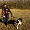 Paula Lomax, Sellersburg, works with Louie, her border collie trained as a recall/refind search and rescue dog, during a training session in Clark County. A search and rescue dog trained in recall/refind will find a subject, return to their handler and lead them to the individual. Staff photo by Christopher Fryer