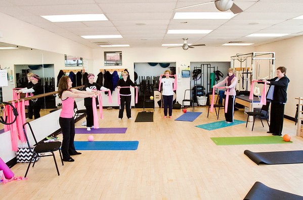 Instructor Susie Stewart, New Albany, far left, leads the Pink Ribbon Pilates class at the Charlestown Road Floyd Memorial Physical Therapy in New Albany. The class is open to breast cancer survivors and patients on Wednesday evenings with sessions at 4:30 p.m. and 5:30 p.m. Staff photo by Christopher Fryer