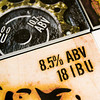 The alcohol content of the New Albanian Brewing Co.'s Solidarity Baltic Porter is displayed on a graphic placard for the beer at the NABC Brewing Company Pizzeria & Public House in New Albany on Tuesday afternoon. An old Indiana law prohibits the advertisement of alcohol content in beer, but Senate Bill 236, if passed, will rewrite a portion of the state's criminal code that includes alcohol offenses. Staff photo by Christopher Fryer