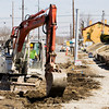 Ron Banet, Greenville, of MAC Construction & Excavating, uses an excavator  to remove portions of the sidewalk and curb along East Main Street in New Albany on Tuesday afternoon. Staff photo by Christopher Fryer