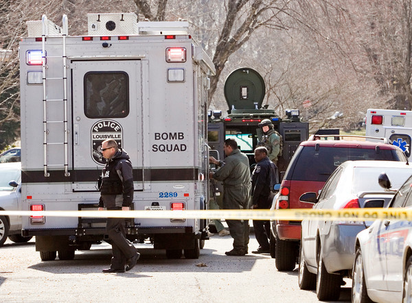 The Louisville Metro Police Department Bomb Squad and the Jeffersonville Police Department SWAT team prepare equipment at the mobile command unit near the intersection of Flintlock Drive and Middle Road during a standoff along the 1700 block of Birch Bark Lane in Jeffersonville on Monday afternoon. The suspect took his own life with a rifle. No others were injured during the incident. Staff photo by Christopher Fryer