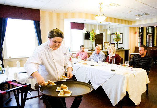 Assistant Director of Culinary Services Amanda Happel, Milltown, serves the judges at the sixth annual Trilogy Health Services Culinary Olympics at The Villages at Historic Silver Crest in New Albany on Thursday afternoon. Happel, of Silver Crest, competed against seven other representatives from the company's campuses in southeast Indiana. Staff photo by Christopher Fryer