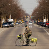 A cyclist crosses East Spring Street at Tenth Avenue in New Albany on Friday afternoon. Staff photo by Christopher Fryer