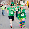 Kelly, right, and Jeff Seewer, both of New Albany, make their way towards the finish line during the sixth annual Leprechaun Run along Chestnut Street in Jeffersonville on Tuesday evening. More than 150 people took part in the two-mile race. Staff photo by Christopher Fryer