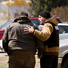 Jeffersonville Police Department Captain Garry Pavey, right, consoles the brother of the suspect that took his own life during a standoff in a residence along the 1700 block of Birch Bark Lane in Jeffersonville on Monday afternoon. No others were injured during the incident. Staff photo by Christopher Fryer