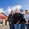 From left, Goodfellas Pizza employees, Kacy Bullock, Salem, Samantha Abbott, Henryville, Robin Mattingly, Sellersburg, and Juli Sherrill, Henryville, stand outside of the Henryville restaurant earlier this week. The restaurant was heavily damaged by the March 2 tornadoes of 2012 and reopened in June of 2013. Staff photo by Christopher Fryer