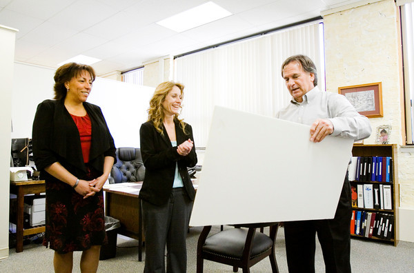 Indiana Department of Correction Commissioner Bruce Lemmon presents Floyd County Community Corrections Director Karen Kruer Bell, center, and Floyd County Superior Court 3 Judge Maria Granger with a performance bonus check at the facility in New Albany on Friday afternoon. Out of the 84 counties measured, Floyd County Community Corrections tied for second place with a score of 96, which was primarily based on facility performance levels, grant scores and site visits. Staff photo by Christopher Fryer