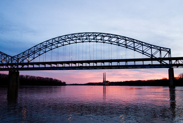 The sun sets as the Ohio River flows beneath the Sherman Minton Bridge near New Albany. Staff photo by Christopher Fryer