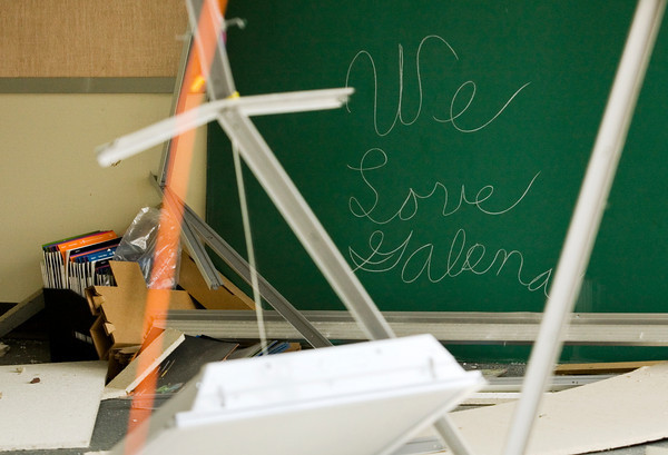 Debris hangs from the ceiling next to a message on a chalk board while a crew from Merrel Bierman Excavating out of Clarksville works to demolish part of the former Galena Elementary School building next to Floyd Central High School on Wednesday afternoon. The majority of the structure will be torn down, but the gymnasium and some classroom space will be left for further use by Floyd Central. Staff photo by Christopher Fryer