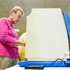 Lois Lopp, New Albany, uses an electronic voting machine to fill out her ballot at Newlin Hall in New Albany on Tuesday afternoon. Staff photo by Christopher Fryer
