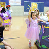 Students of Ms. Shawna Albert's kindergarten class at Bridgepoint Elementary walk through the school gymnasium as part of the schoolbook character parade. Each class decorated a float as a book of their choice, and each student dressed as their favorite characters. <br /> Staff photo by Tyler Stewart