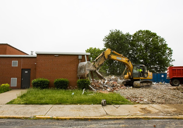 Tom Robinson, with Merrel Bierman Excavating out of Clarksville, operates an excavator while demolishing part of the former Galena Elementary School building next to Floyd Central High School on Wednesday afternoon. The majority of the structure will be torn down, but the gymnasium and some classroom space will be left for further use by Floyd Central. Staff photo by Christopher Fryer