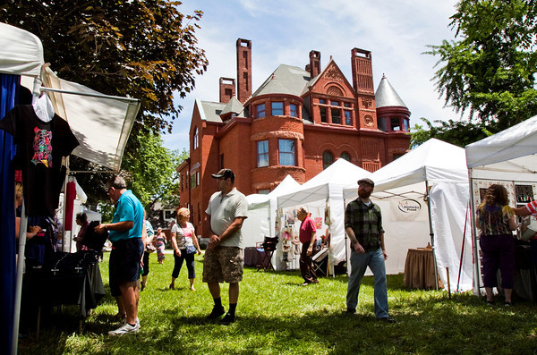 Attendees move between booths and vendors during the Art and Antique Jubilee at the Howard Steamboat Museum in Jeffersonville on Saturday afternoon. Staff photo by Christopher Fryer