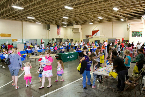 Participants move between booths during the Floyd County Head Start end of year celebration at the Ntional Guard Armory in New Albany on Wednesday morning. Staff photo by Christopher Fryer