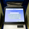A new electronic voting machine is pictured inside the voting center at Newlin Hall in New Albany on Tuesday afternoon. This was the first year that the touchscreen devices were used in Floyd County. Staff photo by Christopher Fryer