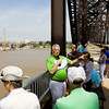 Max Rowland, communications project manager with Walsh Construction, speaks during a public walking tour of the downtown crossing of the Ohio River Bridges Project along the Big Four Bridge on Wednesday morning. Staff photo by Christopher Fryer