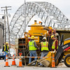A crew with Miller Pipeline works at the corner of Scribner Drive and West Market Street in downtown New Albany on Thursday afternoon as part of a state-wide gas main and service line, pipeline replacement project. Staff photo by Christopher Fryer
