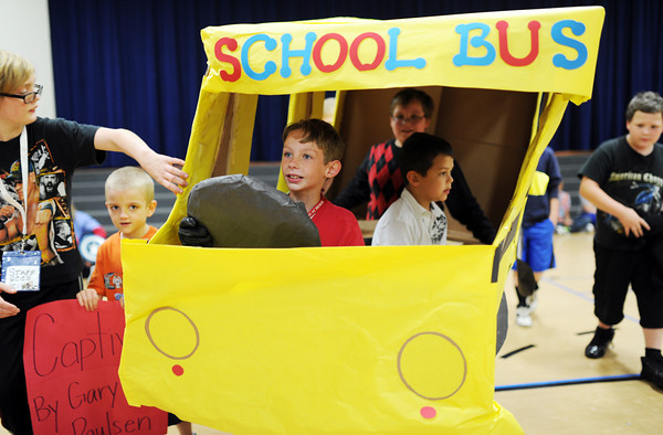 Students of Kara Robert's special needs class at Bridgepoint Elementary drive through Bridgepoint Elementary's gymnasium on Thursday as part of the storybook parade.<br /> Staff photo by Tyler Stewart