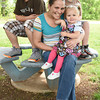 Teryn Applegate, 27, and her three children, David, 12, Dylan, 10, and 20-month-old Gracelynn are pictured above in Corydon Thursday. Applegate has been diagnosed with an inoperable brain tumor and given six months to live in December.<br /> Staff photo by Tyler Stewart