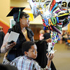 Jamaur Willis, 8, embraces his mother, Jasmine Willis, Jeffersonville, before entering Ivy Tech's 2014 graduation ceremony Tuesday.<br /> Staff photo by Tyler Stewart