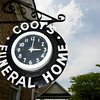 The clock on the side of E.M. Coots' Sons Funeral Home is pictured in downtown Jeffersonville on Thursday afternoon. The owners recently had the clock refurbished with an exterior paint job, neon restoration and clockworks tune-up. The clock has been a part of the funeral home's exterior since the 1940s. Staff photo by Christopher Fryer