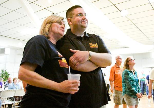 Brad Striegel and his campaign treasurer, Roz Wolverton, look on as primary election results are announced at the Knights of Columbus in New Albany on Tuesday evening. Striegel won the Democratic nomination over Jeff Topping for Floyd County Sheriff. Staff photo by Christopher Fryer