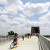 Pedestrians and cyclists move along the Indiana aproach to the Big Four Bridge following the official opening of the Jeffersonville ramp Tuesday afternoon. Staff photo by Christopher Fryer
