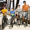 From left, Simon Forsting, Winston Holt, Amanda Forsting, and her husband Richard, all of Louisville, sit on their bicycles following the official opening of the Jeffersonville ramp to the Big Four Bridge on Tuesday afternoon. Staff photo by Christopher Fryer
