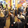 Ivy Tech's 2014 graduating class begin to take position with their educational departments before entering the Northside Christian Church auditorium Tuesday. <br /> Staff photo by Tyler Stewart