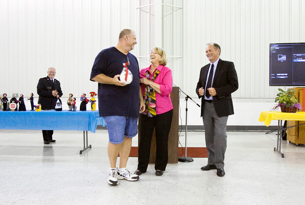 James McCormick, New Albany, center left, is recognized for his volunteer service at The Salvation Army Southern Indiana's annual volunteer luncheon in New Albany on Wednesday. Staff photo by Christopher Fryer