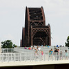 Pedestrians and cyclists move along the Jeffersonville ramp to the Big Four Bridge on Tuesday afternoon. Staff photo by Christopher Fryer