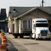 Crews with Stephen Edwards House and Building Movers haul a historic home down Mulberry Street on the way to a lot at the corner of Pearl and Maple streets in Jeffersonville on Thursday morning. Staff photo by Christopher Fryer