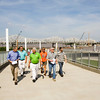 Max Rowland, center, communications project manager with Walsh Construction, leads a public walking tour of the downtown crossing of the Ohio River Bridges Project along the Big Four Bridge on Wednesday morning. Staff photo by Christopher Fryer