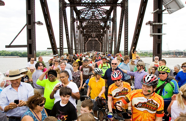 Pedestrians and cyclists wait to cross over into Indiana from the Big Four Bridge at the official opening of the Jeffersonville ramp Tuesday afternoon. Staff photo by Christopher Fryer
