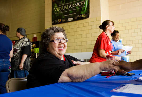 Judy Quick welcomes participants to the Floyd County Head Start end of year celebration at the National Guard Armory in New Albany on Wednesday morning. Quick is retiring from the agency after 35 years. Staff photo by Christopher Fryer