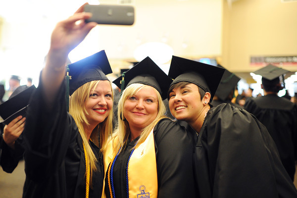 Left to Right: Criminal Justice students Brandi Schuur, Jeffersonville, Greta Baker, Fredericksburg, and Rebecca Moses, New Albany, pose for a picture before heading to Ivy Tech's 2014 graduation ceremony at Northside Christian Church Tuesday.<br /> Staff photo by Tyler Stewart