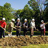 From left, Iain Stewart, the vice president of fields with Southern Indiana United Soccer Club, Irving Joshua, the president of the New Albany Redevelopment Commission, New Albany City Councilman Scott Blair, New Albany Mayor Jeff Gahan, Steve Sipes, president of the New Albany Parks Board, and New Albany Parks Director Alicia Meredith participate in a ground breaking ceremony for the Binford Park improvement project in New Albany on Monday morning. Staff photo by Christopher Fryer