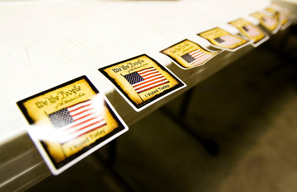 Stickers hang off the side of a table inside the voting center at Newlin Hall in New Albany on Tuesday afternoon. Staff photo by Christopher Fryer