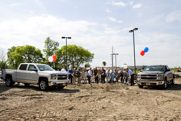 Coyle Chevrolet owners and employees break ground alongside community leaders at a groundbreaking ceremony for the dealership's 12,000 square feet sales floor, showroom and service center addition at their primary location in Clarksville on Monday morning. Staff photo by Christopher Fryer