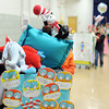 "Erica Hinton's ""Cat in the Hat"" float, designed by first graders at Bridgepoint Elementary, is pushed through the gymnasium Thursday afternoon.<br /> Staff photo by Tyler Stewart"
