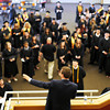 Director of Student Life, Thomas W. Evans, directs students of Ivy Tech's 2014 graduating class to their individual schools before entering the ceremony. <br /> Staff photo by Tyler Stewart
