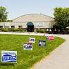 Campaign signs are pictured in front of the voting center at Newlin Hall in New Albany on Tuesday afternoon. The voting site at the Floyd County 4-H Fairgrounds was one of 10 locations in the city and county where voters could cast their ballots. Staff photo by Christopher Fryer